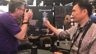 Dan samples a lens at the ProductionHub Happy Hour at NAB 2019.